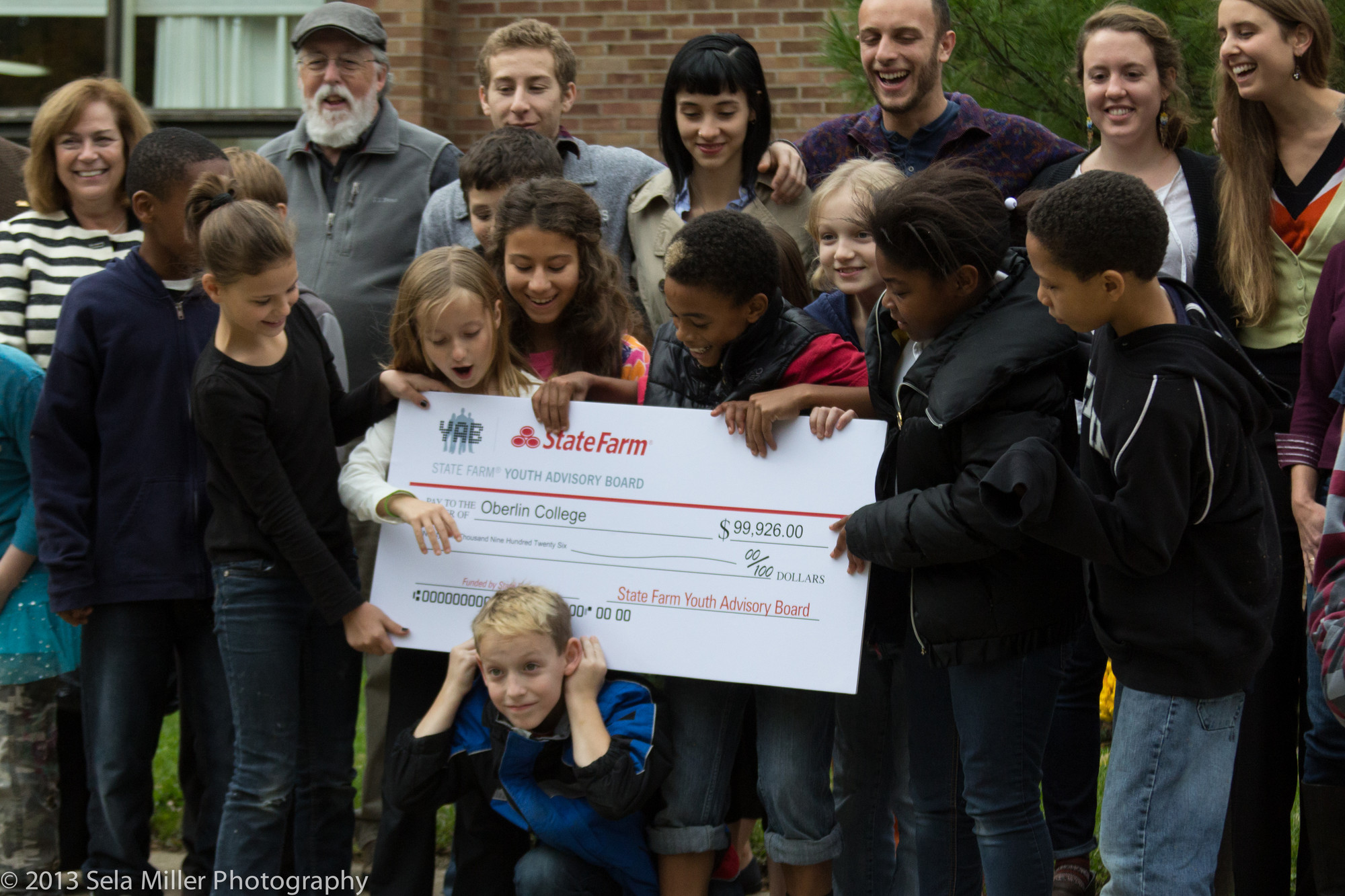 A group of kids receives an oversize check.