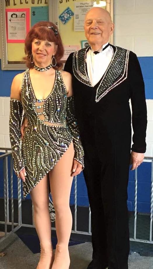A man and a woman in figure skating costumes.